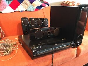 LG 1080P DVD player, subwoofer & 4 surround speakers
