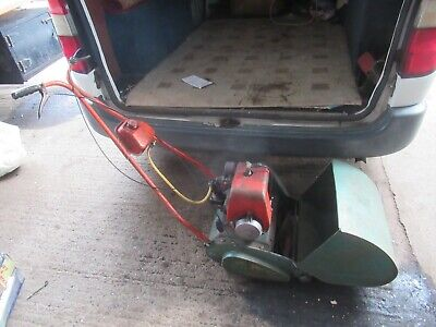 vintage suffolk colt petrol lawnmower with grass box, had it running briefly