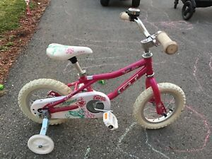"12"" Pink girls bicycle with training wheels"