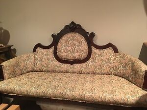Antique sofa with hand carved grape motif