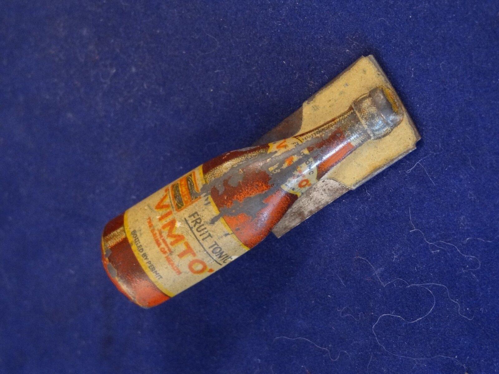 Ancien jouet rare clic-clac tôle lithographiée jus de fruit gazeux vimto pub