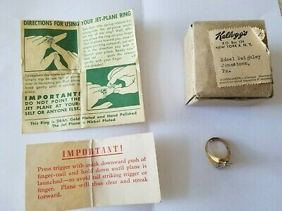 1940s Jewelry Styles and History Kellogg's Pep Cereal Jet Plane Ring w/Directions and Box 1940s 24-kt Gold Plated $139.00 AT vintagedancer.com