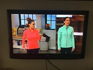 """50"""" LG LCD TV w/ stand and wall mount!"""