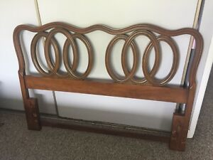 bed frame and wooden headboard