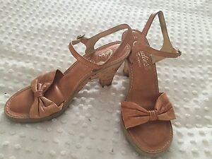 Camel/tan leather heels/ pumps by Candies