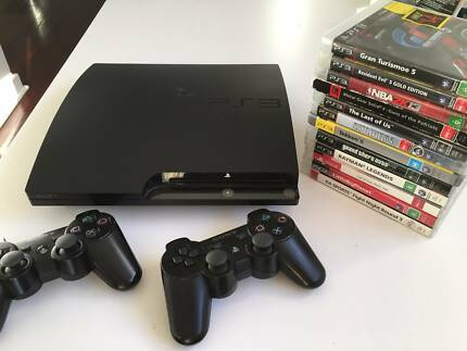 PS3 Slim console + 2 genuine controllers + 12 awesome games
