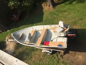 14' boat with 9.9 merc & trailer