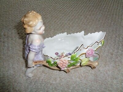 Dresden style young girl baby figurine blond curly hair push cart flowers moving
