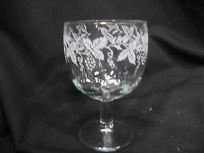 large goblet with frosted etching of grapes and leaves with gold rim