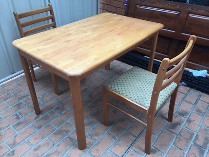 Solid wooden dining table with 2 chairs