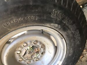 ONE NEW TIRE ON RIM