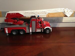 Fire truck and Mack truck with back hoe