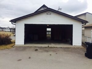 Double detached garage for rent