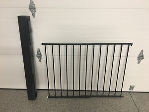 Metal baby gate with additional post