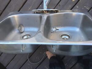 Double kitchen sink with pull out faucet