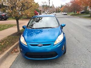 2013 Ford Fiesta SE 4 door hatchback. $7,000