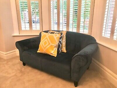 Blue velvet 2 seater sofa. Very good condition as hardly used.