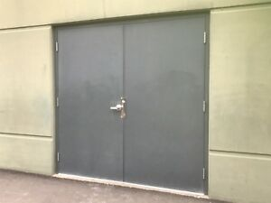 "Pair of insulated steel doors 2@ 3'-6"" x 7'"