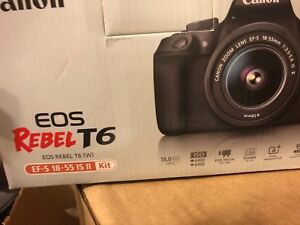 Canon EOS Rebel T6 with 18-55mm II lens