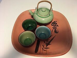 Asian tea set and a servicing plate