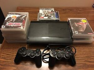 PS3 WITH 2 CONSOLES AND 20+ GAMES