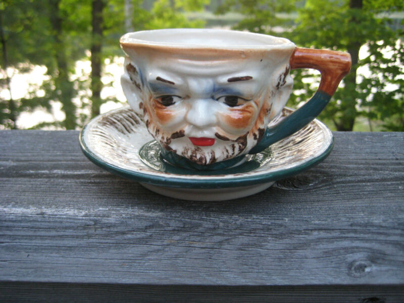 VINTAGE CUP AND SAUCER MAJOLICA STYLE PRIMITIVE LEPRECHAUN