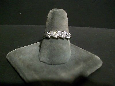 ( 5 STONE CZ RING  - SIZE 7 GENUINE)