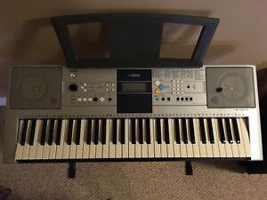 Yamaha electronic keyboard/piano and stand