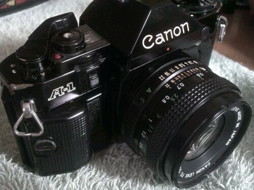 CANON  A1((( CLOSE TO MINT)))    LENS TO !!!