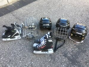 Assorted hockey helmets and skates