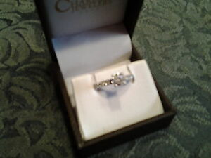14kt white gold .89 carat /size 6 engagement ring
