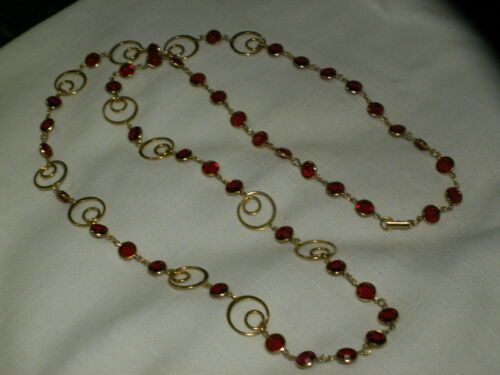 ...Signed SWAROVSKI...Gold Tone Swirl Panels,Red Crystals Necklace...