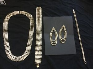 Rhinestone matching necklace, bracelets, and earings