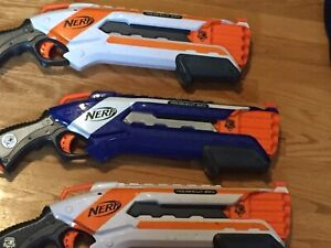 THREE NERF GUNS
