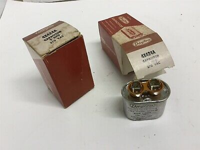 Lot Of 2--- Dayton 4x424a Oil Capacitor 2 Mfd 370 Vac