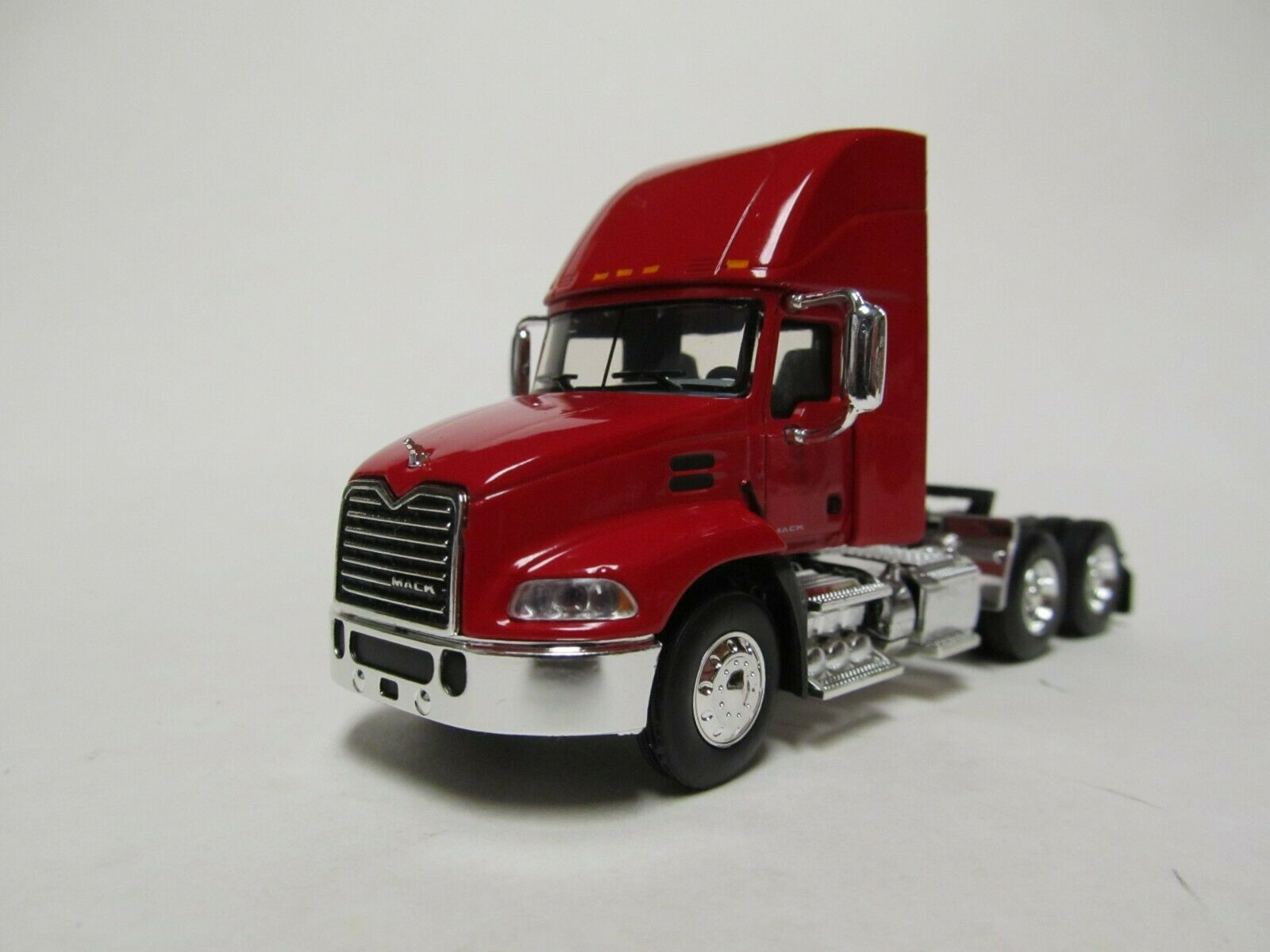 FIRST GEAR / DCP 1/64 SCALE  MACK PINNACLE DAY CAB, RED, BLACK FRAME