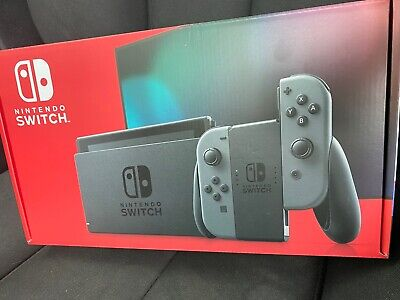 ***New Sealed Nintendo Switch 32GB V2 Console with Gray Joy-Con In Hand***