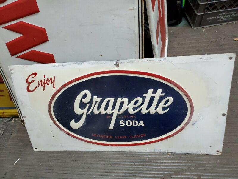 Enjoy Grapette Soda Embossed green back stout Sign 23.8x11.8