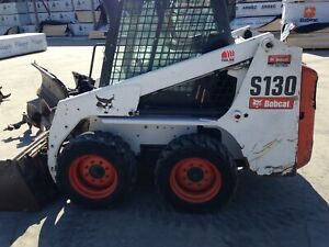 Bobcat with attachments  32,750 obo