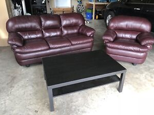 Leather couch and chair with coffee table