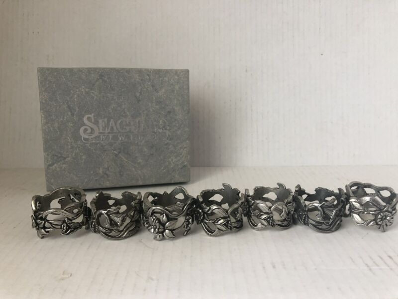 SEAGULL PEWTER SET OF 8 DAFFODIL NAPKIN RINGS