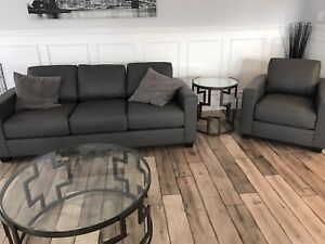 Brand new rounded leather sofa and arm chair