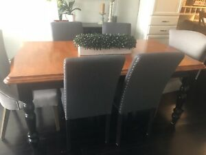 Solid Wood table with  four black wooden chairs