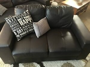 Black faux leather couch, loveseat and chair