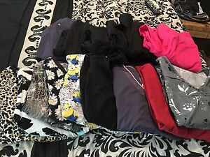 Various scrub tops and bottoms