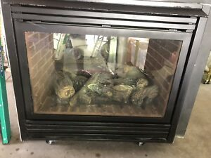 Double Sided Gas Fireplace w/ some exhaust vent