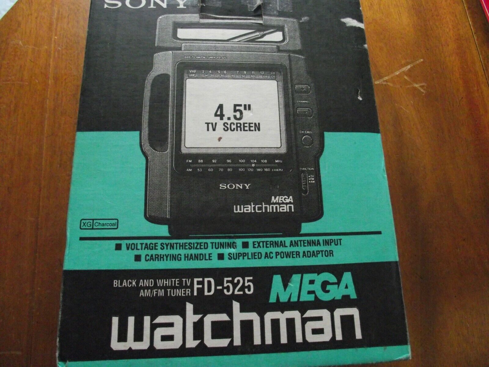"Sony Mega Watchmen FD-525 4.5"" black/white TV with am/fm tuner in box"