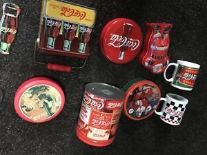 Coca Cola tins and bottle openers