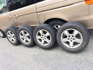 Set of four 225/60R16 Michelin X-Ice snow tires on Honda rims