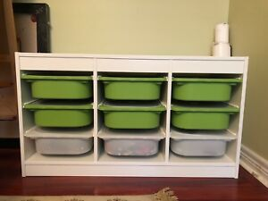 White and green organizer bins with wooden frame.
